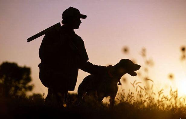 Охотник с собакой