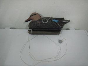 Чучело на верёвке с грузом
